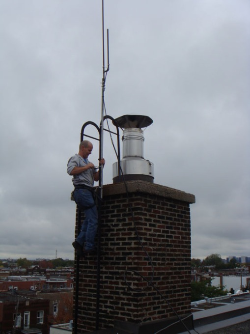 Dan is getting the J antenna installed on the chimney ladder